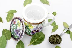 Cup for herbs. Stock Photos