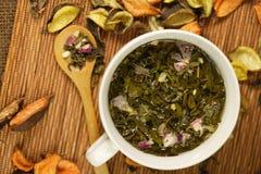 Cup of herbs Stock Photos