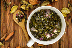 Cup of herbs Stock Images