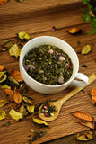 Cup of herbs Royalty Free Stock Photos