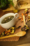 Cup of herbs Stock Image