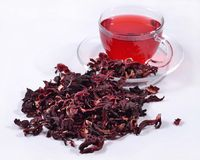 Cup of hibiscus tea and a dried petals of hibiscus Stock Image