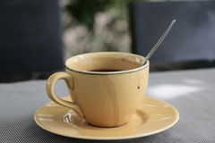 Cup of hot drink. Yellow cup for serve hot drink Royalty Free Stock Photo