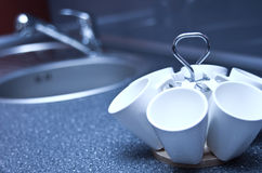 Cup holder in kitchen Stock Images