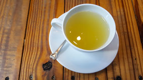 A cup of honey lime. On wood table royalty free stock photo