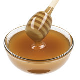 Cup of honey with wooden dipper Stock Image