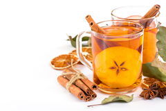 Cup of hot apple cider with cinnamon, anise and orange Royalty Free Stock Photography