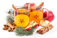 Cup of hot apple cider with cinnamon, anise and orange Royalty Free Stock Image