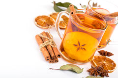 Cup of hot apple cider with cinnamon, anise and orange Stock Image