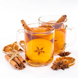 Cup of hot apple cider with cinnamon, anise and orange Stock Photos
