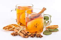 Cup of hot apple cider with cinnamon, anise and orange Stock Photo