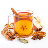 Cup of hot apple cider with cinnamon, anise and orange Royalty Free Stock Images