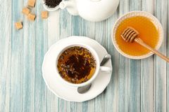 Cup of hot aromatic tea with honey on table stock photography