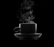 Cup of hot beverage on black Stock Photo