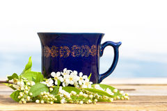 Cup of hot beverage with cherry blossom Stock Photo