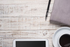 Cup of hot black coffee and diary, smartphone on wood table Royalty Free Stock Photography