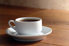 Cup of Hot Black Coffee on Kitchen Wood table Stock Image