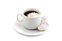 Cup of hot black coffee with a marshmallows  isolated on a  white background Royalty Free Stock Images