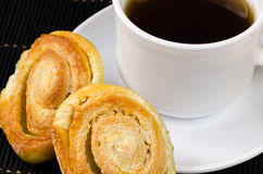 Cup of hot black tea, lemon, homemade cookies Royalty Free Stock Image