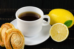 Cup of hot black tea, lemon, homemade cookies Royalty Free Stock Images