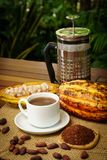 Cup of hot brewed cacao drink made in french press, raw cocoa fruit, beans, nibs. Cup of hot brewed cacao drink made in french press, raw cocoa fruit, cacao Stock Photos