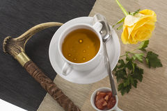A cup of hot broth, with noodles, and vegetables decorated for g Stock Photography