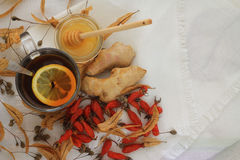 A cup of hot broth . Top view. Tea rosehip and ginger, honey in a glass on the table. The concept of health Stock Photo