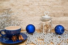 A cup of hot chocolate, blue and silver colors, Christmas mock u royalty free stock images