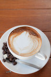 Cup of hot caffe latte with coffee grain Royalty Free Stock Photos
