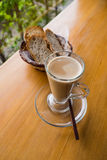 A cup of hot cappuccino and bread Stock Image