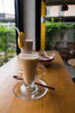 A cup of hot cappuccino with Chocolate banana smoothie and bread Royalty Free Stock Photo