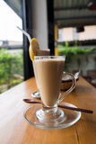 A cup of hot cappuccino with Chocolate banana smoothie and bread Stock Images
