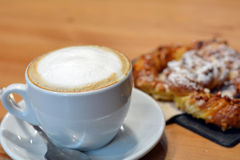 Cup Of Hot Cappuccino And Dessert On The Wooden Table Stock Photo