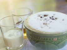 Cup of hot cappuccino on the table with a glass of milk and hone. Y, selective focus Stock Photo