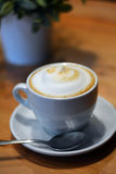 Cup Of Hot Cappuccino On The Wooden Table Royalty Free Stock Image