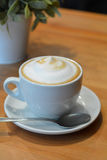 Cup Of Hot Cappuccino On The Wooden Table Royalty Free Stock Images
