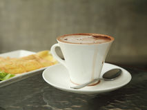 Cup of hot chocolate with art creamy milk Stock Image