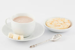 Cup of hot chocolate with cheese and arepa Stock Image