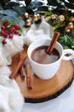 A Cup of Hot Chocolate with Christmas Decoartion. A cup of hot chocolate with Christmas decoration on background stock images