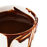 Cup of hot chocolate cocoa flow on white background, close up Stock Photography