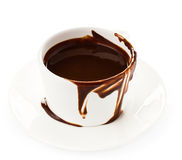 Cup of hot chocolate cocoa flow on white background, close up Royalty Free Stock Image