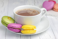 A cup of hot chocolate with colorful macarons. Closeup Royalty Free Stock Images