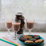 A cup of hot chocolate with cookies. A cup of hot chocolate or latte with cookies Royalty Free Stock Photos
