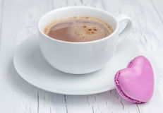 A cup of hot chocolate with a  heart-shaped macaron. (horizontal Royalty Free Stock Photography