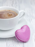 A cup of hot chocolate with a  heart-shaped macaron (vertical). A cup of hot chocolate with a  heart-shaped macaron Stock Images