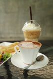 Cup of hot chocolate with ice coffee. In cafe Royalty Free Stock Photography