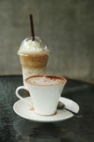 Cup of hot chocolate with ice coffee. In cafe Stock Photo