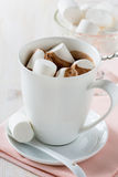 Cup of hot chocolate  with marshmallow on a white table Royalty Free Stock Photo