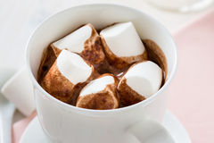 Cup of hot chocolate  with marshmallow on a white table Royalty Free Stock Image