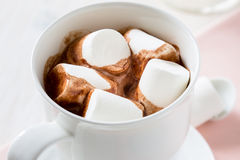 Cup of hot chocolate  with marshmallow on a white table Stock Photography
